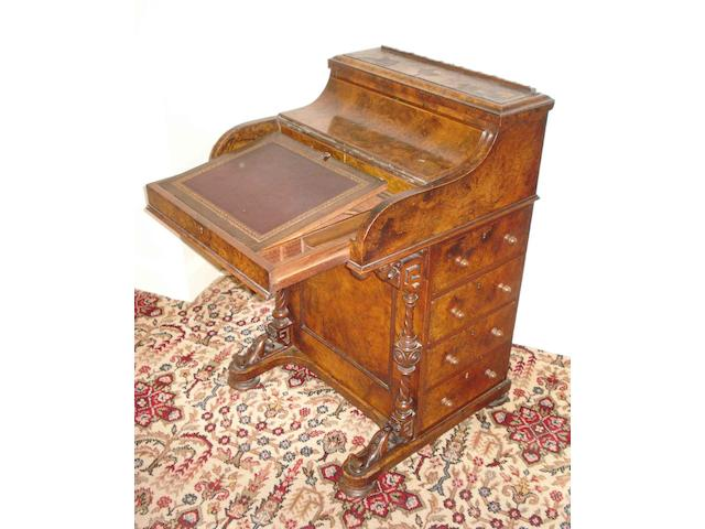 A 19th century walnut pop up piano front davenport