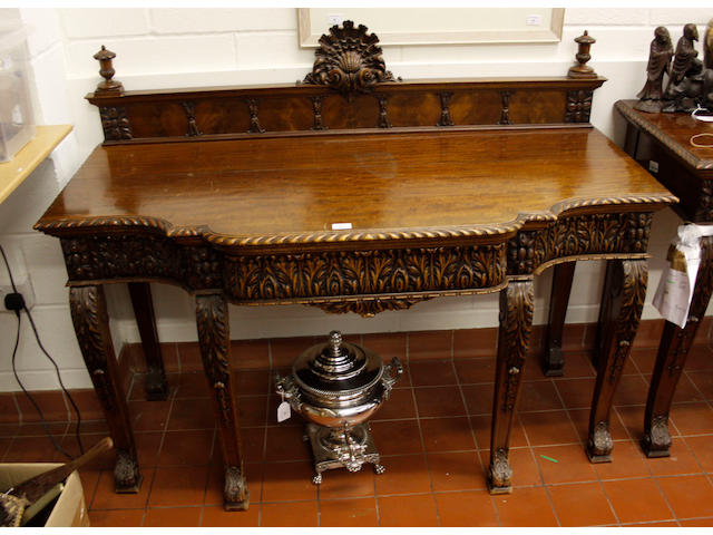 A Chippendale style mahogany serving table,on acanthus carved scrolled legs, 145cm wide and a matching sideboard. (2)