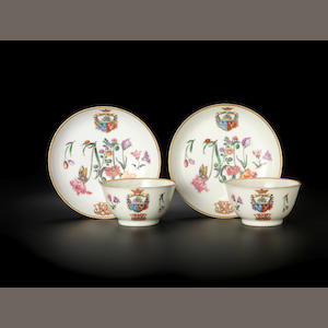 A rare pair of famille rose armorial teabowls and saucers for the Dutch market Circa 17