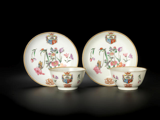 A rare pair of famille rose armorial teabowls and saucers for the Dutch market Circa 1740