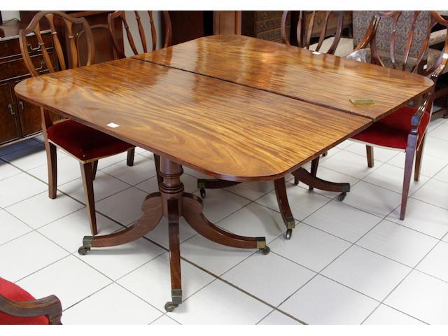 A Regency style mahogany dining table,
