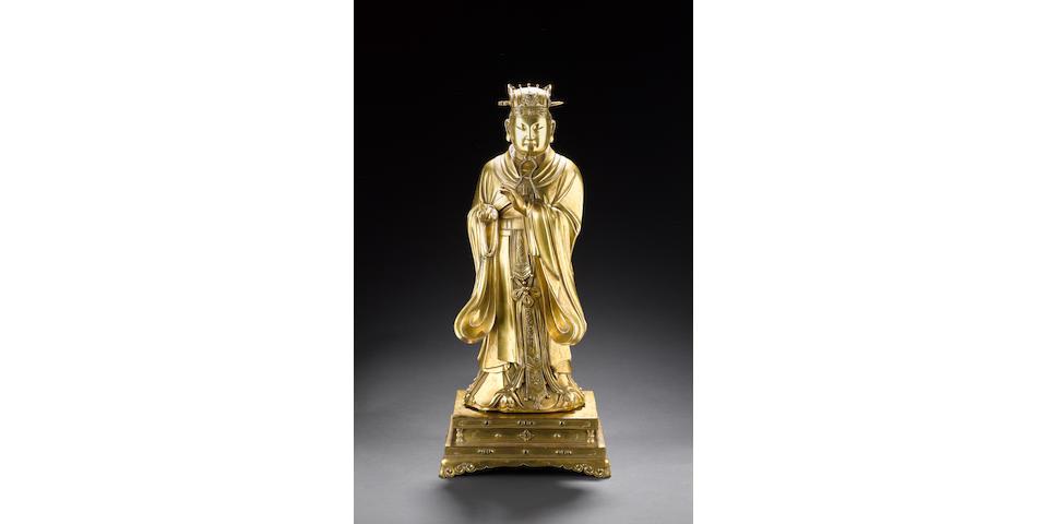 A gilt bronze figure of a standing Scholar or Deity