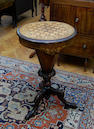 A Victorian walnut sewing and games table