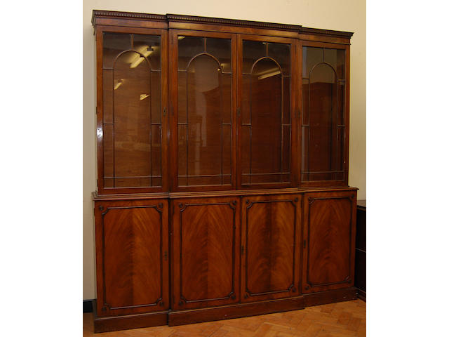 A mahogany breakfront library bookcase, 20th Century, in George III style