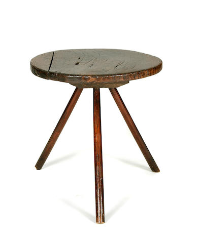 A primitive oak cricket table