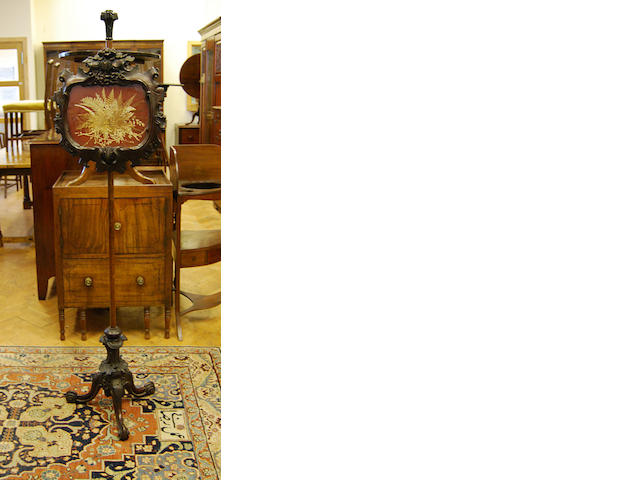 A Victorian carved walnut pole screen