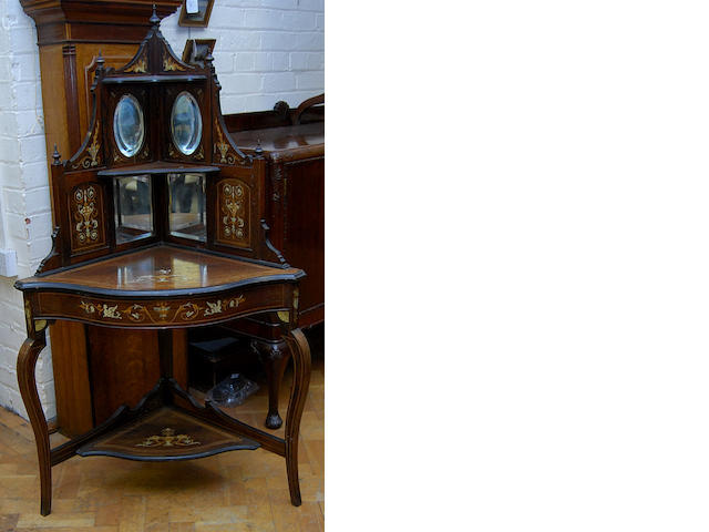 An Edwardian rosewood and inlaid bowfront corner whatnot