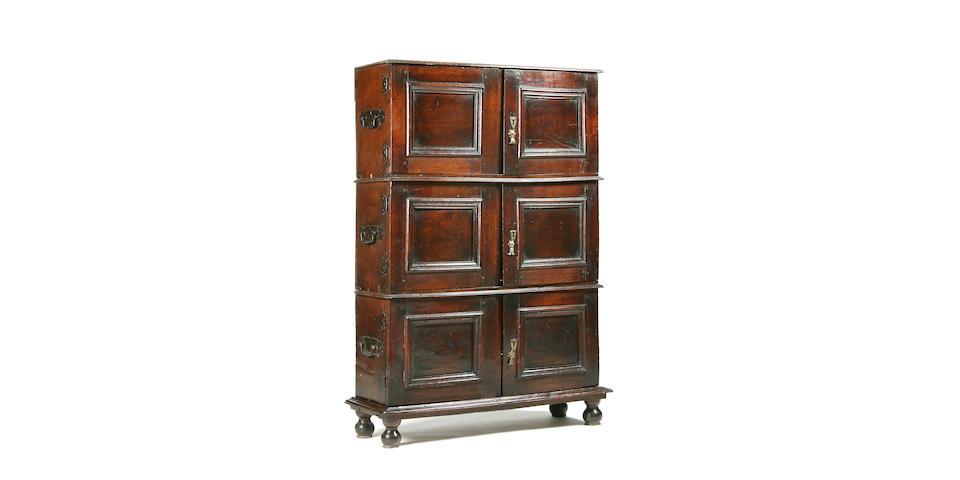 A rare late 17th Century oak segmental cupboard