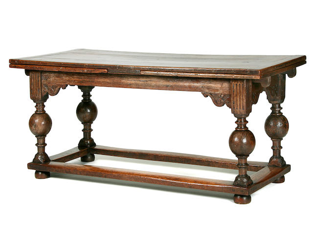 A 17th Century oak draw-leaf table, Flemish
