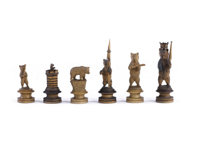 "A ""Bear of Berne"" pearwood figural chess set, Switzerland, circa 1870,"