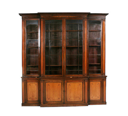 A William IV rosewood and grained rosewood, satinwood and marquetry breakfront library bookcase