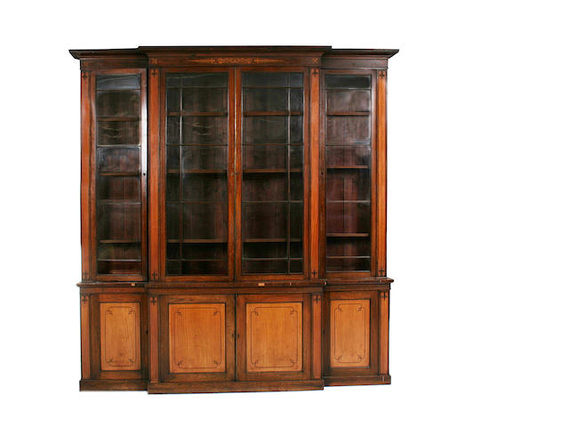 A mahogany, satinwood and marquetry breakfront library bookcase  in the Regency style
