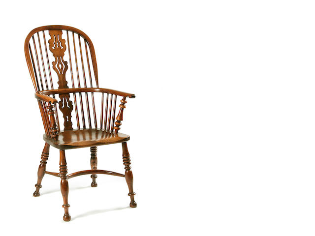 A mid 19th Century yew high back Windsor chair