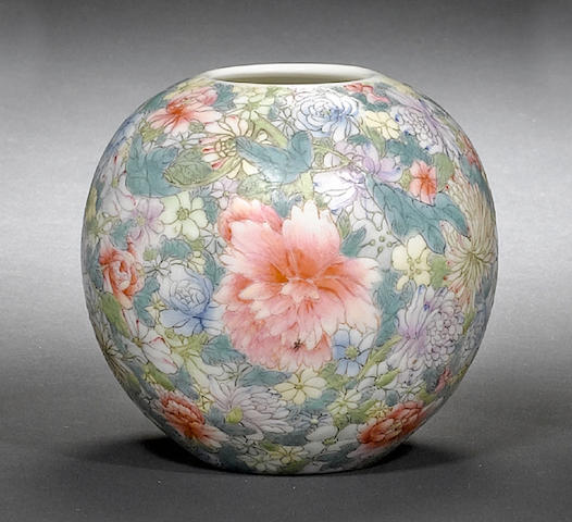 A famille rose 'millefleurs' oviform vase with six-character Qianlong mark; together with