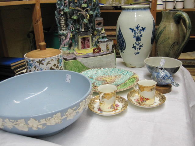 A set of eleven Majolica leaf moulded dessert plates, Chinese ornamental group of buildings and figures before rockwork, Isnik baluster vase, part set of Hammersley & Co coffee cans and saucers painted with flowers, Davenport jar, Wedgwood embossed Queens ware fruit bowl and other ceramics.