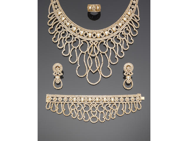 A diamond necklace, bracelet, ring and earring parure (4)