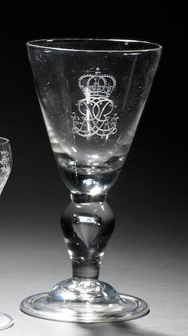 A large engraved George I Royal commemorative heavy baluster goblet circa 1715
