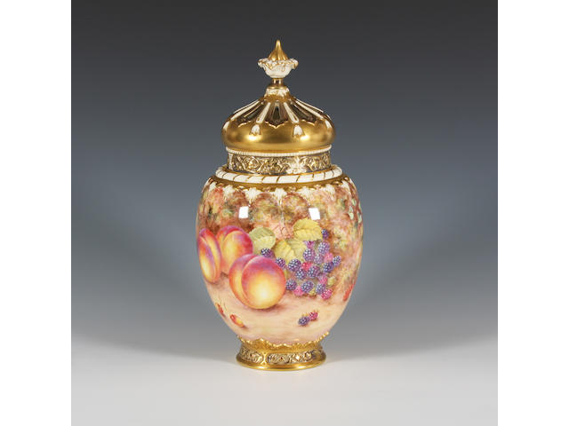 A Royal Worcester fruit painted vase and cover by John Freeman Circa 1970.