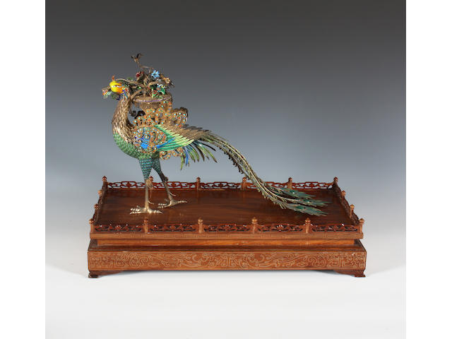 A Chinese cloisonné-enamelled and white metal model of a peacock Early 20th Century.