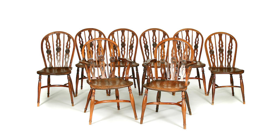A set of eight yew, elm and ash Windsor chairs, to include two open armchairs, attributed to the Prior Workshop, Uxbridge