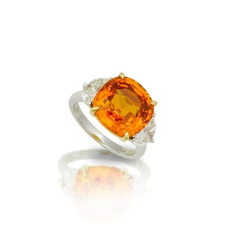 A spessartite garnet and diamond ring