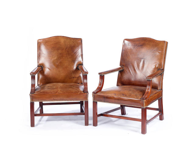 A pair of George III style mahogany Gainsborough armchairs