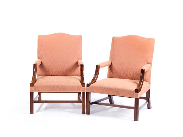 A pair of of George III style mahogany Gainsborough armchairs