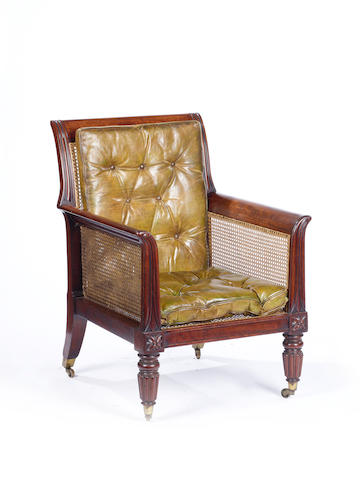 A William IV mahogany and caned library bergere