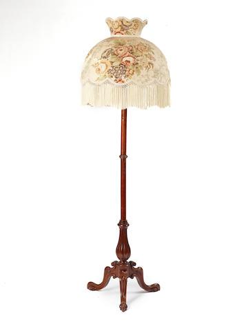 A Victorian walnut standard lamp