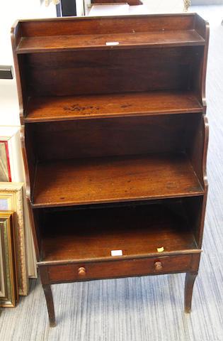 A Regency mahogany four tier waterfall bookcase,