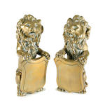 A pair of cast brass lion-form newel post finials19th Century