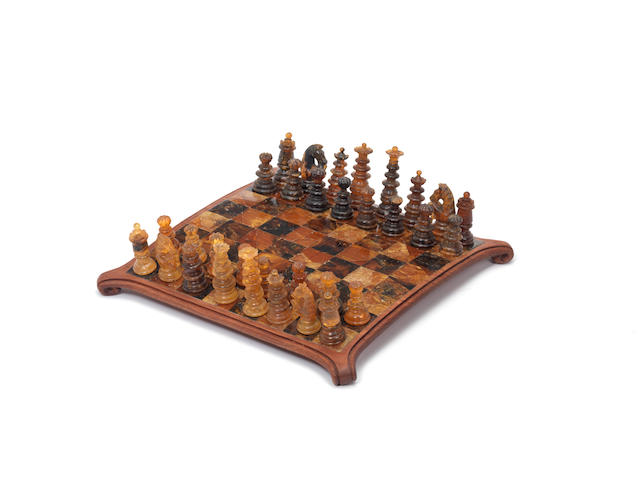An amber chess set and board, circa 1960,
