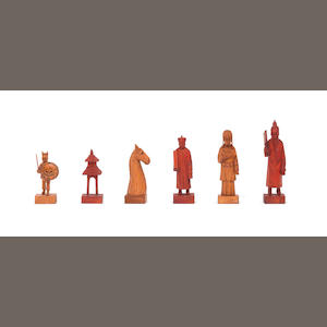 A carved wooden figural chess set, China, circa 1920,
