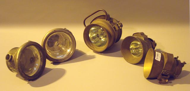 A selection of 5 brass bodied lamps,