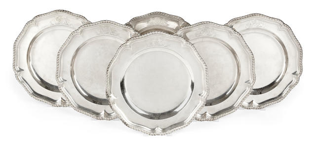 A set of six George III sterling silver shaped circular plates, London 1761, by Frederick Kandler,