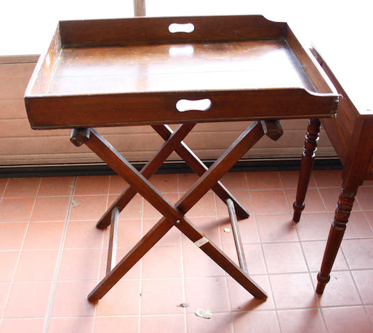 A late George III mahogany butler's tray on a folding stand