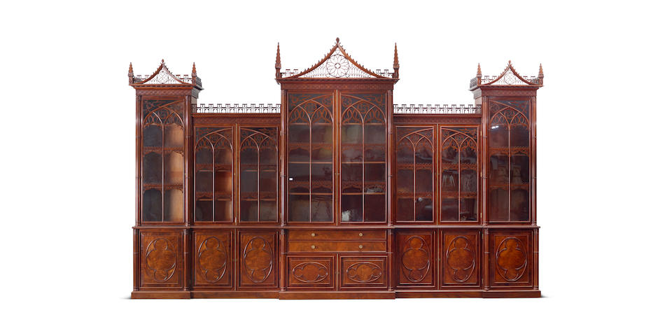 A fine and imposing George IV double breakfront mahogany library bookcase in the Gothic style attributed to Gillows