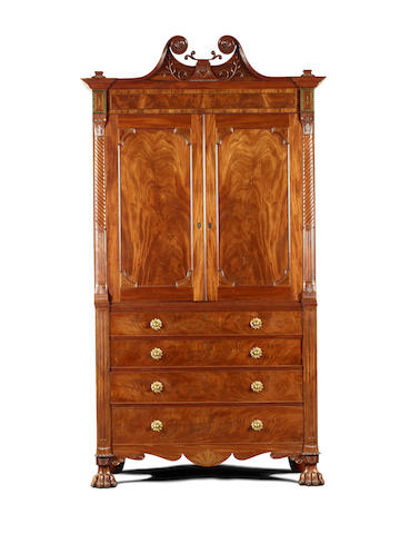 An imposing Regency Channel Islands mahogany and brass inlaid linen press