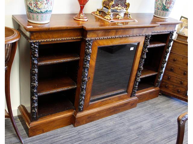 A Victorian walnut breakfront side cabinet
