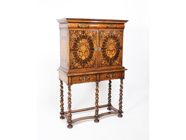A William and Mary style figured walnut, oyster veneered and floral marquetry inlaid cabinet on stand, early 20th century