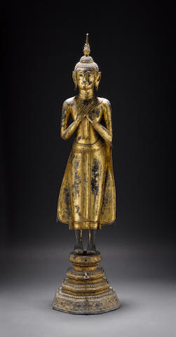 A Thai gilded bronze, or other alloy, figure of a standing Buddhist Deity, probably Sakyamuni (The Historical Buddha) or Ananda (The Buddha's First Cousin)