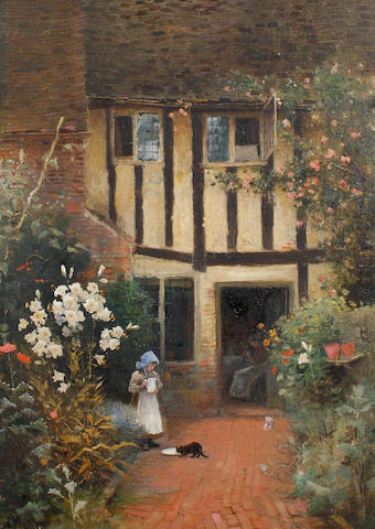 Arthur Claude Strachan (British, 1865-1938) A girl feeding a cat outside a cottage