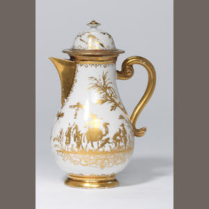 A Meissen Augsburg decorated gilt jug and cover (cover repaired)