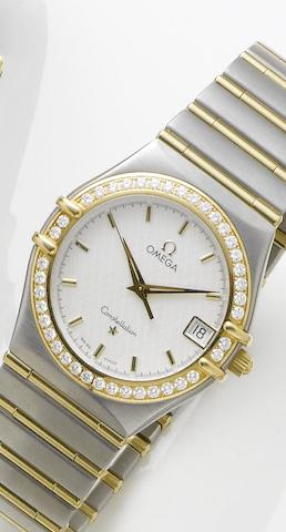 Omega. A quartz stainless steel and gold diamond set centre seconds calendar bracelet watch together with fitted boxConstellation, 1990's