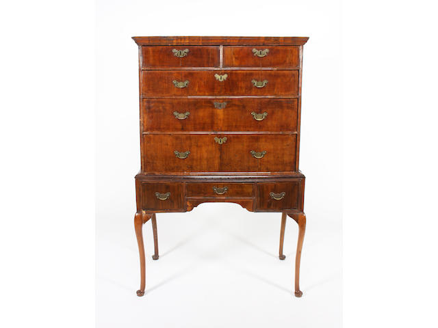 A George II and later, walnut and feather banded chest on later stand