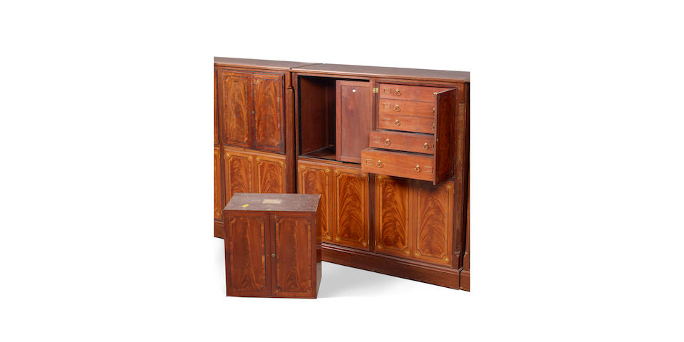An important and rare set of twelve George III Australian red cedar collector's cabinets
