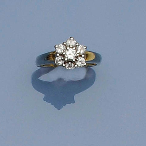 A diamond cluster dress ring