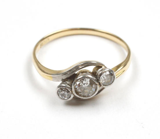 A three stone crossover diamond ring,