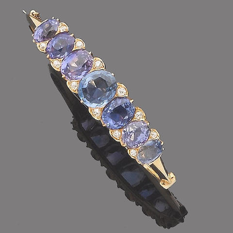 A late 19th century sapphire and diamond hinged bangle,
