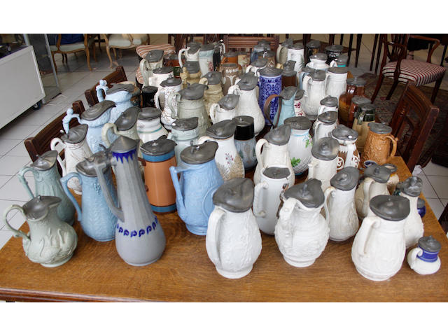 A large collection of 19th Century Staffordshire saltglazed jugs